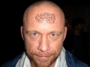 Buddy sporting an Andrea Gibson tatoo